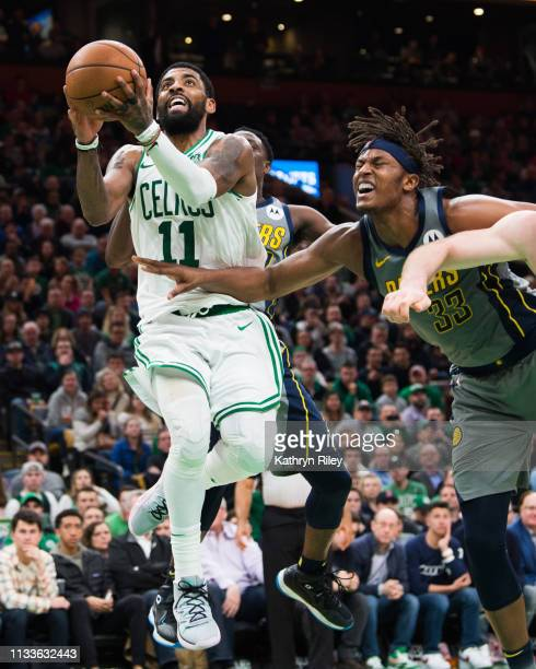 Kyrie Irving of the Boston Celtics drives to the basket against Myles Turner of the Indiana Pacers at TD Garden on March 29 2019 in Boston...
