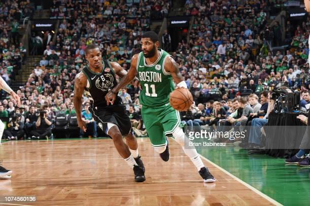 Kyrie Irving of the Boston Celtics drives to the basket against the Milwaukee Bucks on December 21 2018 at the TD Garden in Boston Massachusetts NOTE...