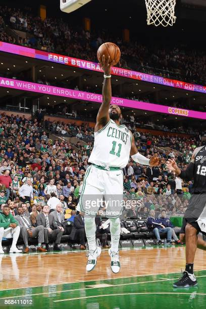 Kyrie Irving of the Boston Celtics drives to the basket against the San Antonio Spurs on October 30 2017 at the TD Garden in Boston Massachusetts...