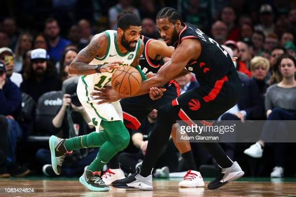 Kyrie Irving of the Boston Celtics drives to the basket during a game against the Toronto Raptors at TD Garden on January 16 2019 in Boston...