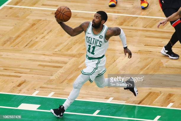 Kyrie Irving of the Boston Celtics drives to the basket during the first half against the Toronto Raptors at TD Garden on November 16 2018 in Boston...