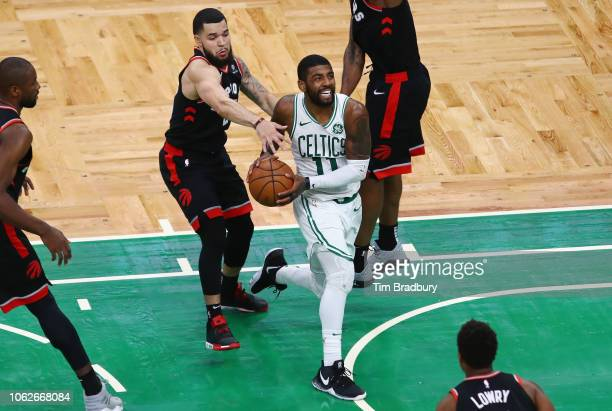 Kyrie Irving of the Boston Celtics drives to the basket during overtime against the Toronto Raptors at TD Garden on November 16 2018 in Boston...
