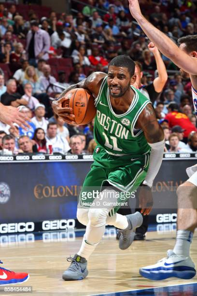 Kyrie Irving of the Boston Celtics drives to the basket during the game against the Philadelphia 76ers during a preseason on October 6 2017 at Wells...