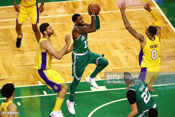 Kyrie Irving of the Boston Celtics drives to the basket during the fourth quarter against the Los Angeles Lakers at TD Garden on November 8 2017 in...