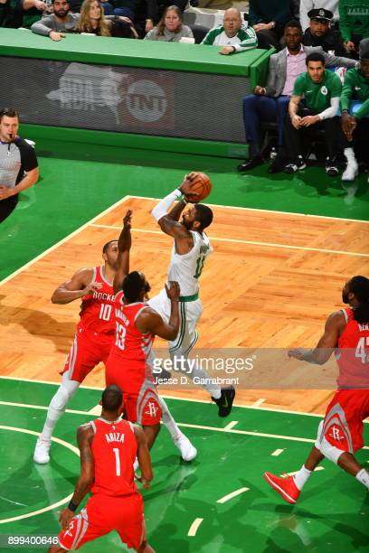 Kyrie Irving of the Boston Celtics drives to the basket during the game against the Houston Rockets on December 28 2017 at the TD Garden in Boston...