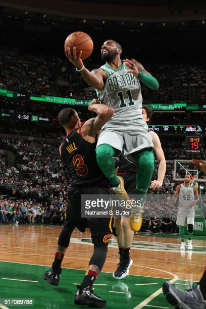 Kyrie Irving of the Boston Celtics drives to the basket during the game against the Cleveland Cavaliers on February 11 2018 at TD Garden in Boston...