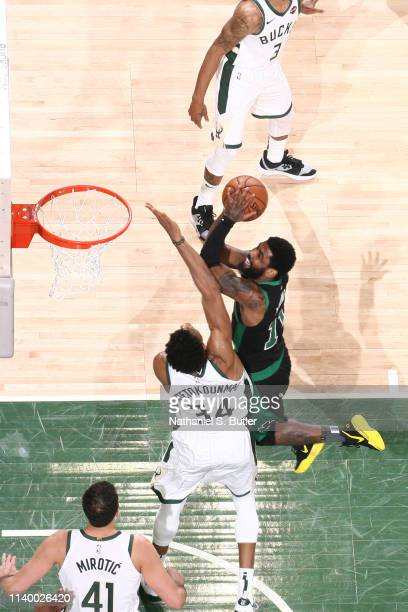 Kyrie Irving of the Boston Celtics drives to the basket for layup against the Milwaukee Bucks during Game One of the Eastern Conference Semifinals of...