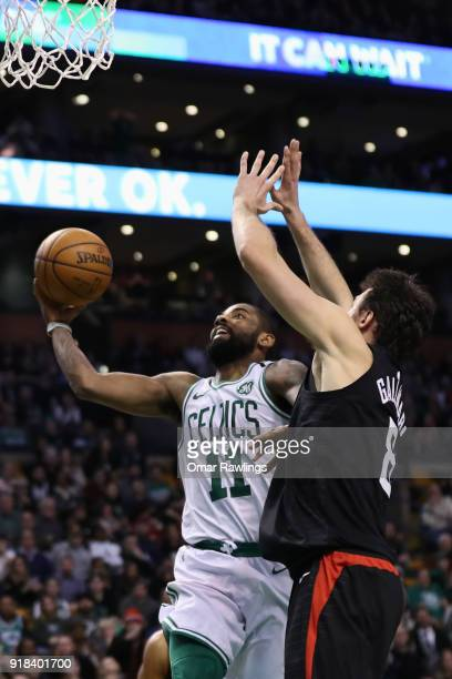 Kyrie Irving of the Boston Celtics drives to the basket on Danilo Gallinari of the LA Clippers during the fourth quarter of the game at TD Garden on...