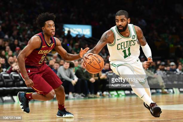 Kyrie Irving of the Boston Celtics drives to the basket past Collin Sexton of the Cleveland Cavaliers during a game at TD Garden on November 30 2018...