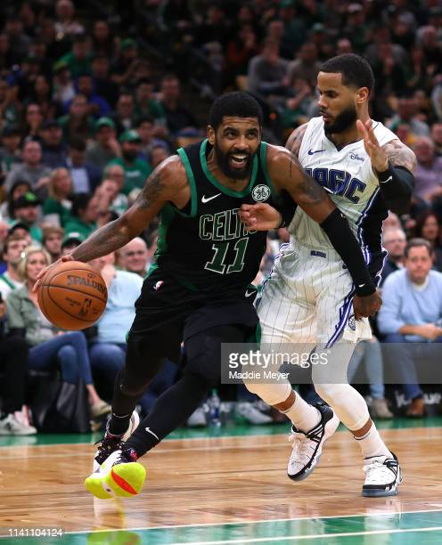 Kyrie Irving of the Boston Celtics drives to the basket past DJ Augustin of the Orlando Magic during the second half at TD Garden on April 07 2019 in...