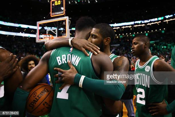 Kyrie Irving of the Boston Celtics embraces Jaylen Brown after the Celtics defeat the Golden State Warriors 9288 at TD Garden on November 16 2017 in...