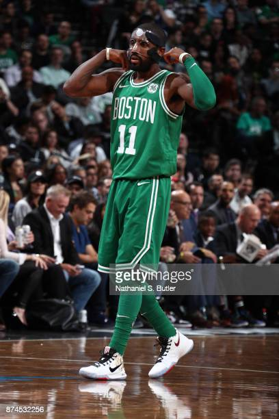 Kyrie Irving of the Boston Celtics fixes his mask during the game against the Brooklyn Nets on November 14 2017 at Barclays Center in Brooklyn New...