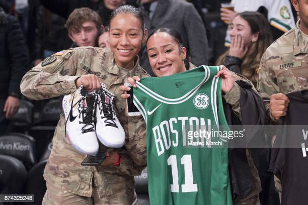 Kyrie Irving of the Boston Celtics gives his shoes and his jersey to United States Veterans after the NBA game against the Brooklyn Nets at Barclays...