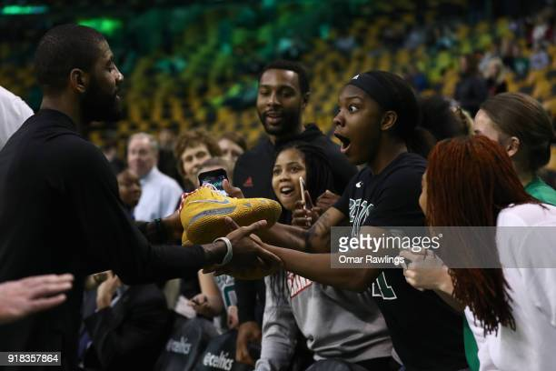 Kyrie Irving of the Boston Celtics gives his sneakers to a fan before the game between the Boston Celtics and the LA Clippers at TD Garden on...