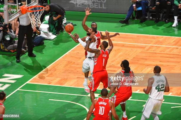 Kyrie Irving of the Boston Celtics glides to the basket during the game against the Houston Rockets on December 28 2017 at the TD Garden in Boston...