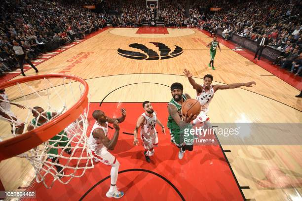 Kyrie Irving of the Boston Celtics goes to the basket against the Toronto Raptors on October 19 2018 at Scotiabank Arena in Toronto Ontario Canada...