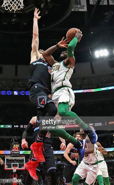Kyrie Irving of the Boston Celtics goes up for a shot against Lauri Markkanen of the Chicago Bulls at the United Center on February 23 2019 in...