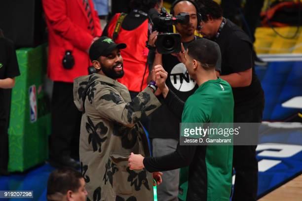 Kyrie Irving of the Boston Celtics greets Jayson Tatum of the USA Team during the Mountain Dew Kickstart Rising Stars Game during AllStar Friday...