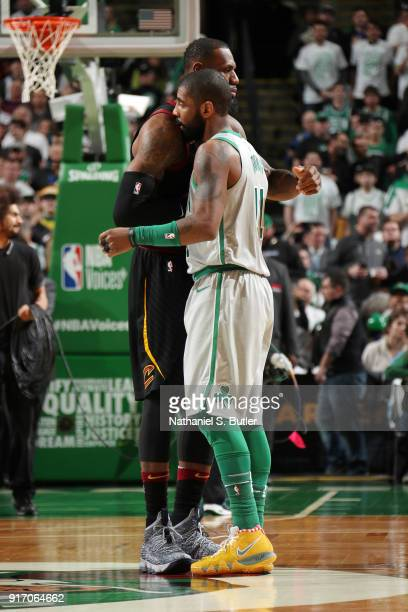Kyrie Irving of the Boston Celtics greets LeBron James of the Cleveland Cavaliers before the game on February 11 2018 at TD Garden in Boston...