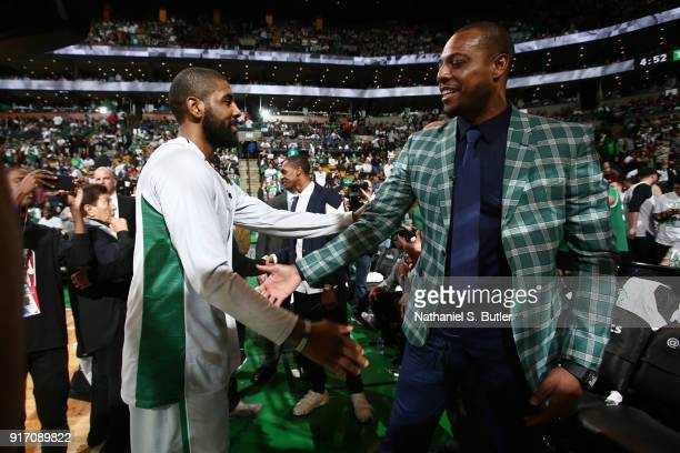 Kyrie Irving of the Boston Celtics greets Paul Pierce during the game against the Cleveland Cavaliers on February 11 2018 at TD Garden in Boston...