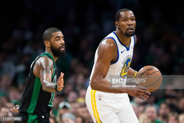 Kyrie Irving of the Boston Celtics guards Kevin Durant of the Golden State Warriors during a game at TD Garden on January 26 2019 in Boston...