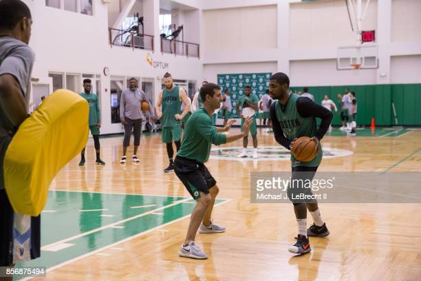 Kyrie Irving of the Boston Celtics handles the ball against Brad Stevens of the Boston Celtics during open practice on September 29 2017 at the...