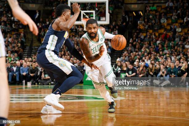Kyrie Irving of the Boston Celtics handles the ball against Malik Beasley of the Denver Nuggets on December 13 2017 at the TD Garden in Boston...