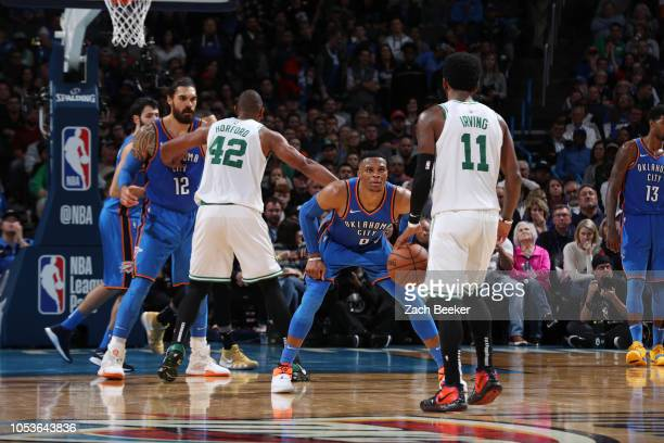 Kyrie Irving of the Boston Celtics handles the ball against Russell Westbrook of the Oklahoma City Thunder on October 25 2018 at Chesapeake Energy...