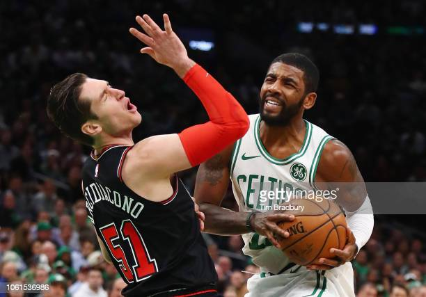 Kyrie Irving of the Boston Celtics handles the ball against Ryan Arcidiacono of the Chicago Bulls during the first half at TD Garden on November 14...
