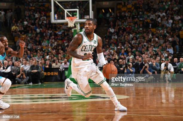 Kyrie Irving of the Boston Celtics handles the ball against the Charlotte Hornets during a preseason game on October 2 2017 at the TD Garden in...