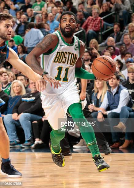 Kyrie Irving of the Boston Celtics handles the ball against the Dallas Mavericks on November 24 2018 at the American Airlines Center in Dallas Texas...