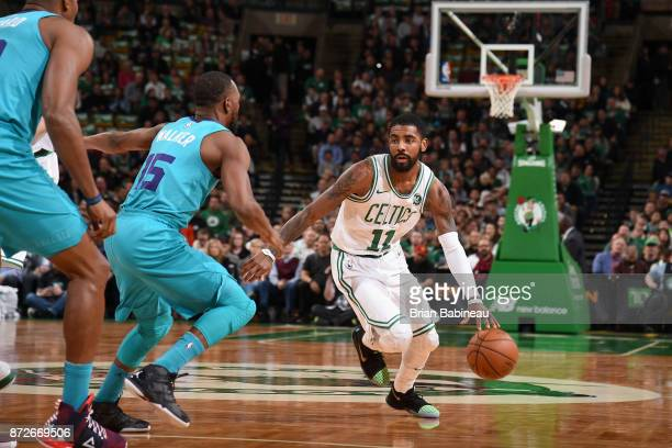 Kyrie Irving of the Boston Celtics handles the ball against the Charlotte Hornets on November 10 2017 at the TD Garden in Boston Massachusetts NOTE...