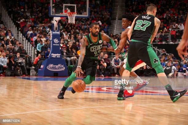 Kyrie Irving of the Boston Celtics handles the ball against the Detroit Pistons on December 10 2017 at Little Caesars Arena in Detroit Michigan NOTE...