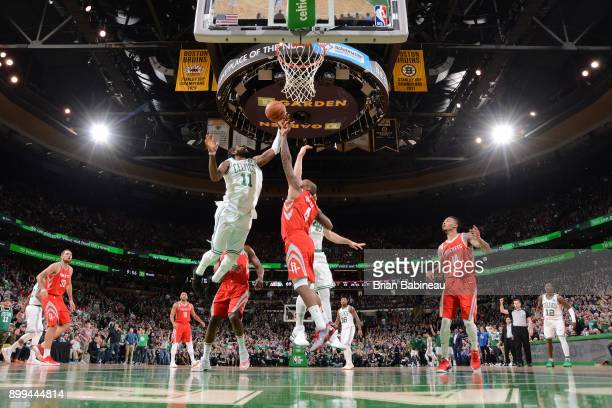 Kyrie Irving of the Boston Celtics handles the ball against the Houston Rockets on December 28 2017 at the TD Garden in Boston Massachusetts NOTE TO...