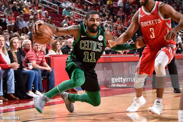 Kyrie Irving of the Boston Celtics handles the ball against the Houston Rockets on March 3 2018 at the Toyota Center in Houston Texas NOTE TO USER...