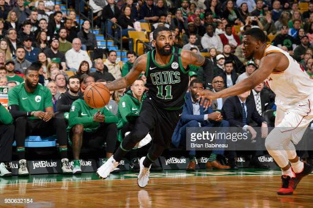 Kyrie Irving of the Boston Celtics handles the ball against the Indiana Pacers on March 11 2018 at the TD Garden in Boston Massachusetts NOTE TO USER...
