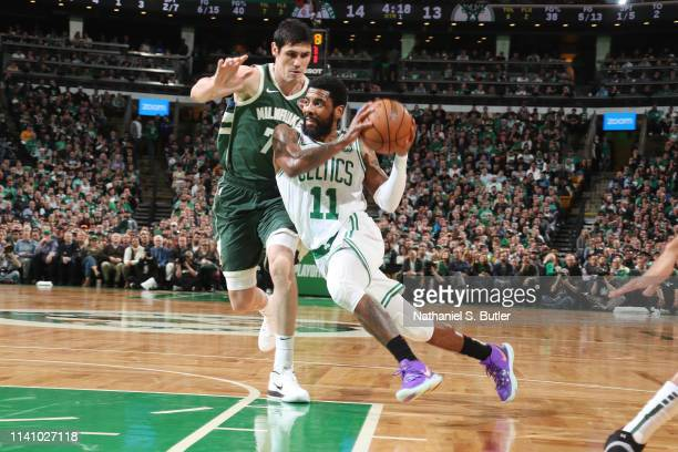 Kyrie Irving of the Boston Celtics handles the ball against the Milwaukee Bucks during Game Three of the Eastern Conference Semi Finals of the 2019...