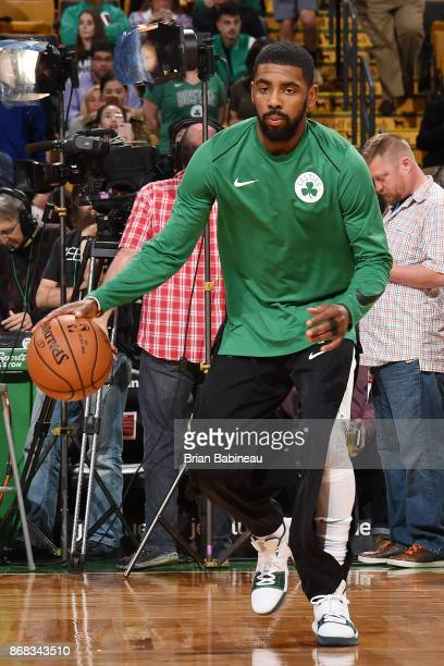 Kyrie Irving of the Boston Celtics handles the ball before the game against the San Antonio Spurs on October 30 2017 at the TD Garden in Boston...