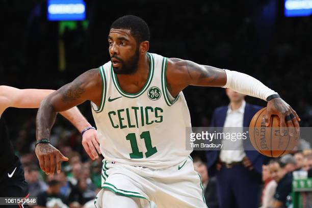 Kyrie Irving of the Boston Celtics handles the ball during the first half against the Chicago Bulls at TD Garden on November 14 2018 in Boston...