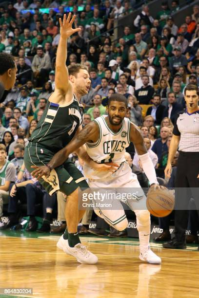 Kyrie Irving of the Boston Celtics handles the ball during the game against the Milwaukee Bucks on October 18 2017 at the TD Garden in Boston...