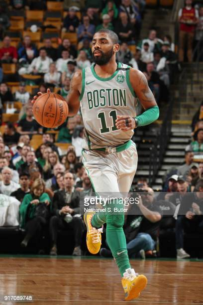 Kyrie Irving of the Boston Celtics handles the ball during the game against the Cleveland Cavaliers on February 11 2018 at TD Garden in Boston...