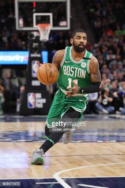 Kyrie Irving of the Boston Celtics handles the ball during the game against the Minnesota Timberwolves on March 8 2018 at Target Center in...