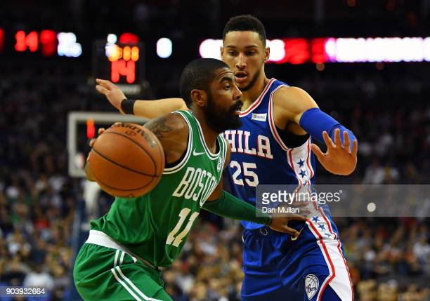 Kyrie Irving of the Boston Celtics holds off Ben Simmons of the Philadelphia 76ers during the NBA game between Boston Celtics and Philadelphia 76ers...