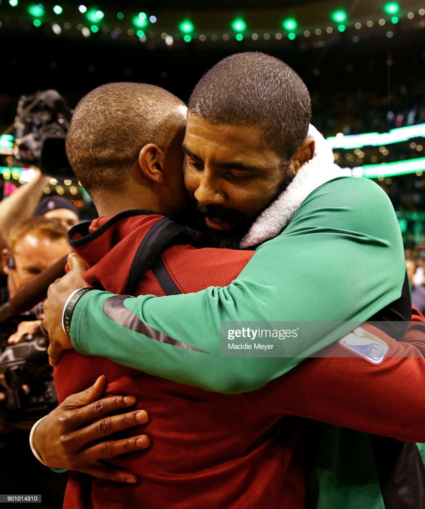 Kyrie Irving #11 of the Boston Celtics hugs Isaiah Thomas #3 of the Cleveland Cavaliers after the Celtics defeat the Cavaliers 102-88 at TD Garden on January 3, 2018 in Boston, Massachusetts.
