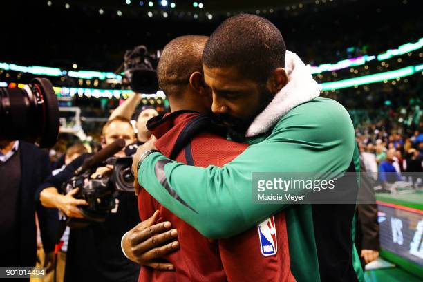 Kyrie Irving of the Boston Celtics hugs Isaiah Thomas of the Cleveland Cavaliers after the Celtics defeat the Cavaliers 10288 at TD Garden on January...