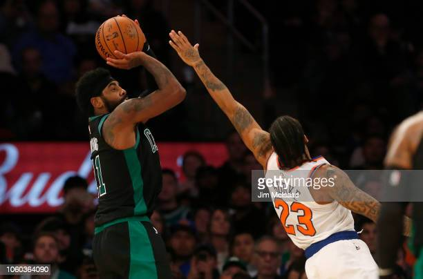 Kyrie Irving of the Boston Celtics in action against Trey Burke of the New York Knicks at Madison Square Garden on October 20 2018 in New York City...