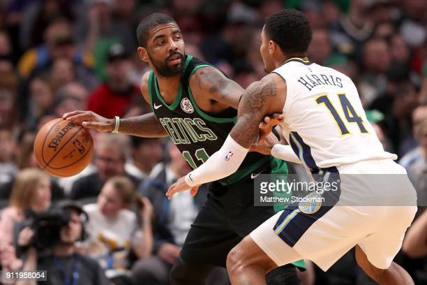 Kyrie Irving of the Boston Celtics is guarded by Gary Harris of the Denver Nuggets at the Pepsi Center on January 29 2018 in Denver Colorado NOTE TO...