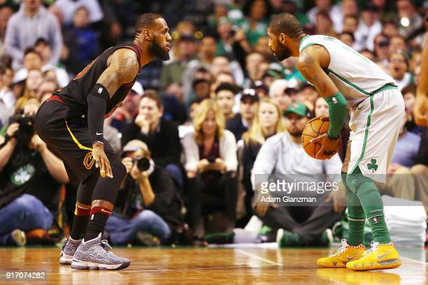 Kyrie Irving of the Boston Celtics is guarded by Lebron James of the Cleveland Cavaliers during the first quarter of a game at TD Garden on February...