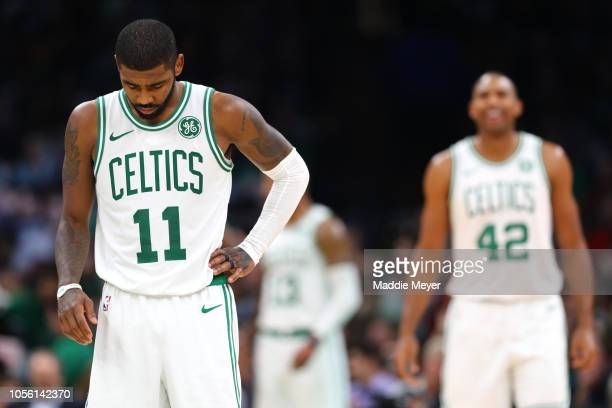 Kyrie Irving of the Boston Celtics looks on during the game between the Boston Celtics and the Milwaukee Bucks at TD Garden on November 1 2018 in...