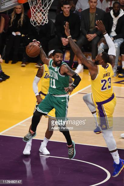 Kyrie Irving of the Boston Celtics looks to pass against LeBron James of the Los Angeles Lakers on March 9 2019 at STAPLES Center in Los Angeles...